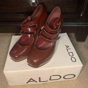 Burgundy platform Aldo heels size 10.